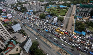 A huge traffic jam on the Western Express Highway near Mumbai as the police strictly enforce a 2km travel restriction for all residents except essential service goers