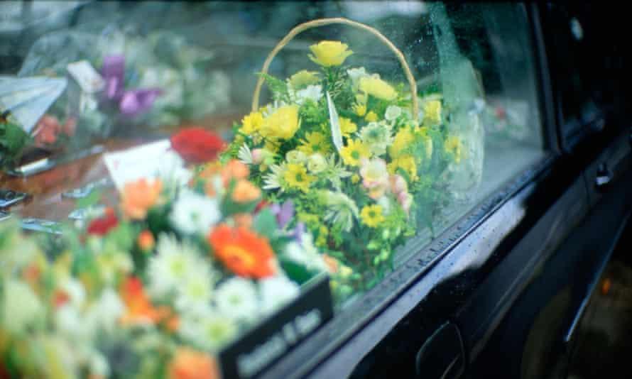 Flowers in window of undertaker's hearse