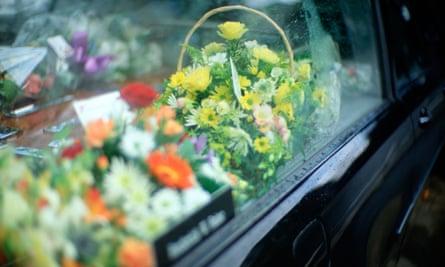 Detail of flowers in window of undertaker's hearse