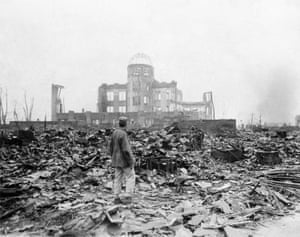 An allied correspondent stands in the rubble of Hiroshima a month after the atomic bomb attack that killed 140,000 people.
