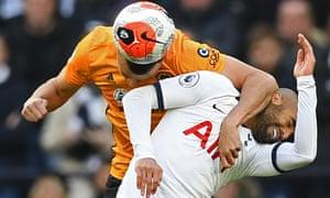 Wolves' Romain Saiss (left) vies with Tottenham Hotspur's Lucas Moura in the Premier League