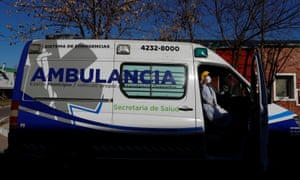 A health care worker takes a sun bath in an ambulance outside the Dr. Alberto Antranik Eurnekian hospital in Ezeiza, on the outskirts of Buenos Aires, Argentina, 21 August 2020.