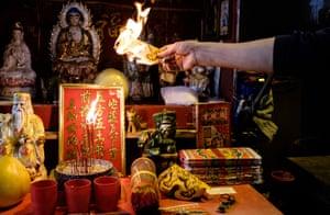 A villain hitter burns a paper effigy representing evil spirits