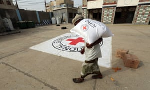 A displaced man receives aid distributed by the International Committee of the Red Cross in Hodeidah, Yemen.