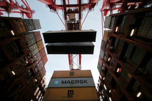 Containers are seen unloaded from the Maersk's Triple-E giant container ship Maersk Majestic, one of the world's largest container ships, at the Yangshan Deep Water Port, part of the Shanghai Free Trade Zone.