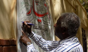Sudanese poet Azhari Mohammed Ali signing a petition to lift the suspension.