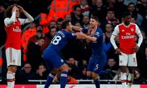 Jorginho (second right) celebrates after scoring Chelsea's equaliser against Arsenal.