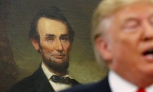 A portrait of Abraham Lincoln hangs in the background as Donald Trump speaks at the White House.