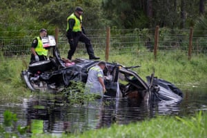 Police officers salvage a damaged vehicle in North Port