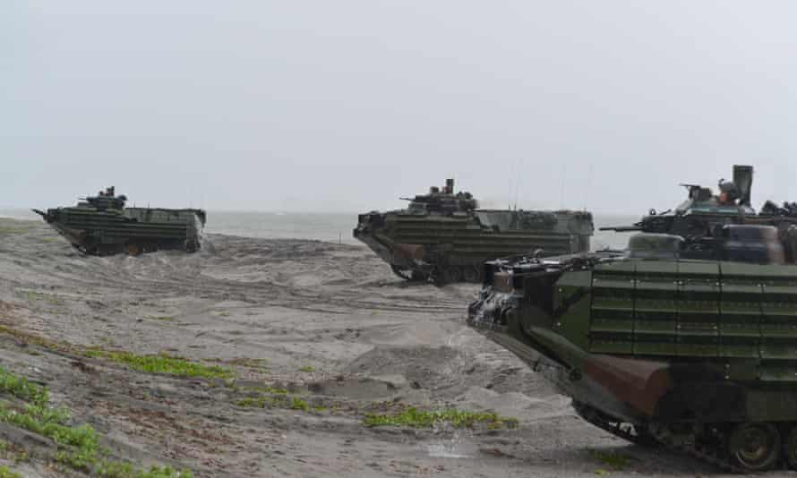 US marines amphibious assault vehicles land on a beach during military exercises with their Philippine marine counterparts on Friday in Zambales province, Philippines.
