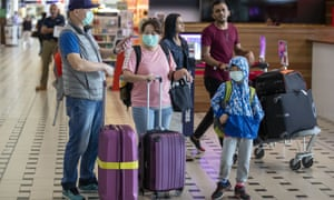 People wearing protective face masks to protect themselves at Brisbane airport