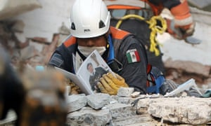 Members of Mexico's army carry out rescue works in a Tlalpan apartment building. A woman was believed to be alive amid the ruins in the area.