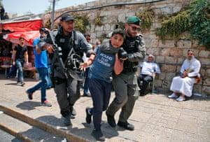 Jerusalem, Israel Border guards detain a Palestinian youth