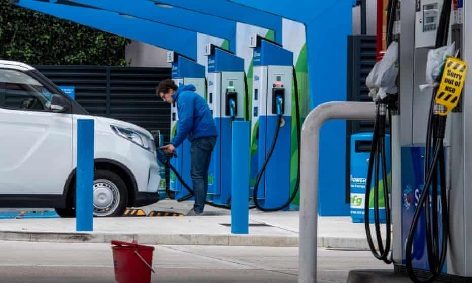 A motorist plugs his electric van to a charge point last week while petrol and diesel pumps are closed. Two-thirds of people polled by Greenpeace UK in 41 Tory seats want to see more investment in electric vehicles.