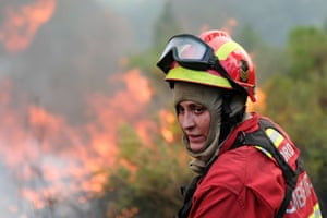 Tabua, PortugalA firefighter fights with a forest fire at S. Geraldo. More than 348 firemen, 86 land vehicles and 10 helicopters and airplanes are battling the fire