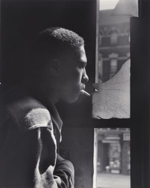 Trapped in abandoned building by a rival gang on street, Red Jackson ponders his next move, 1948