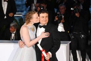 Actor Maria-Victoria Dragus kisses Romanian director Cristian Mungiu
