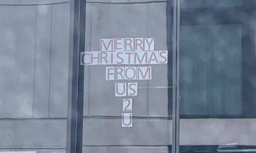 Image taken by Browyn Young while in hotel isolation, Sydney, Australia, Dec 2020, of her impromptu Christmas arts and crafts window display and that of the opposite office building