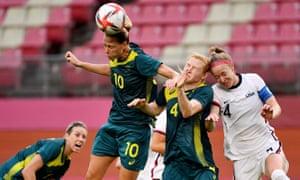 Australia's midfielder Emily van Egmond (second left) heads the ball