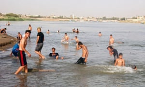 Iraqis swim to cool off in the Tigris river in Baghdad.