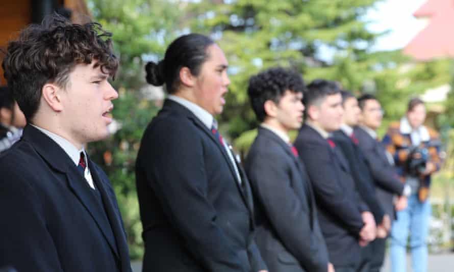 Students await the arrival of Prime Minister Jacinda Ardern to Tamaki Maori Village in Rotorua,