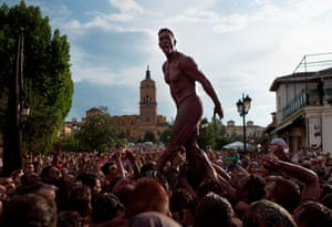 """Guadix, SpainA man covered in black grease shouts above the crowd during the traditional festivities of the Cascamorras, near Granada. Every September 6, a villager from Guadix, performing the """"Cascamorras"""" oddball character, walks three kilometres to the village of Baza to stage an attempt to recapture a statue of the Pieta virgin before returning to Guadix, after three days, where he will be punished by locals for his failure"""