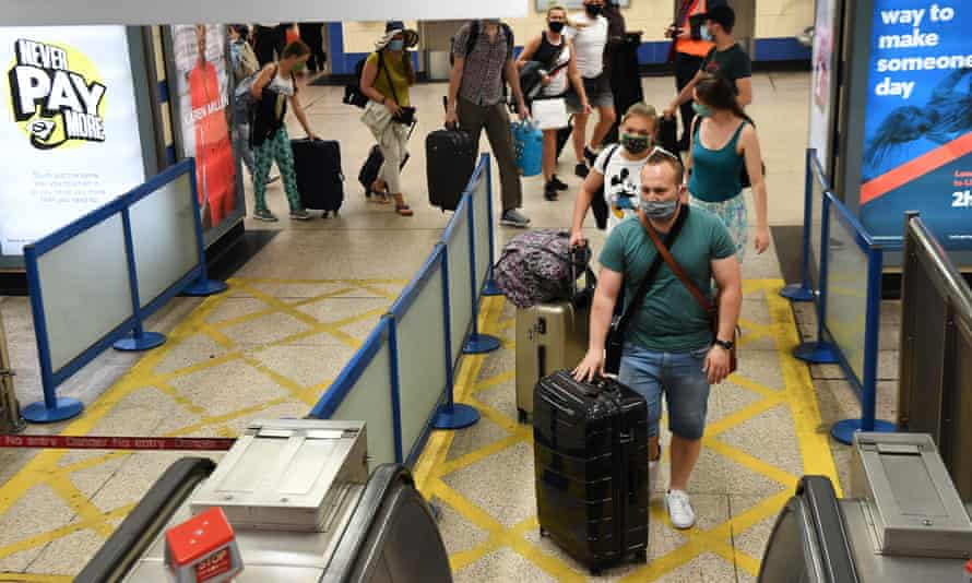 Passengers arrive at Heathrow from Spain.