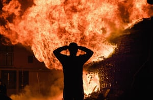 A spectator at the bonfire in Sandy Row