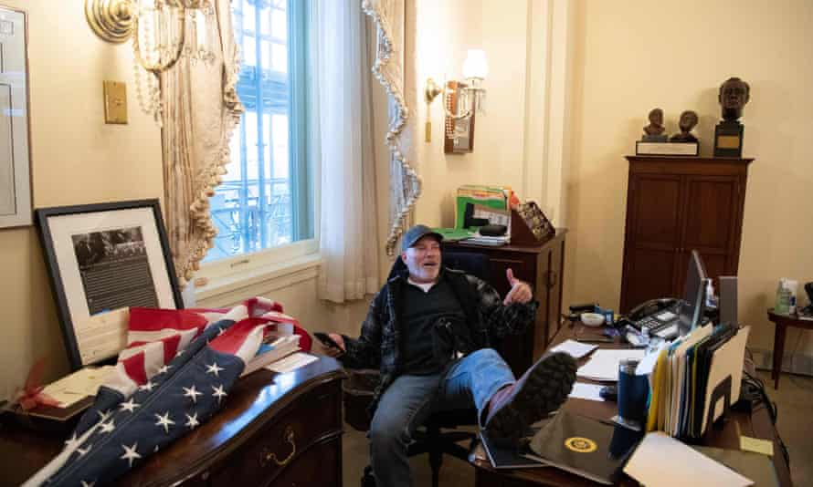 Richard Barnett in the speaker's office during the Capitol attack in January. Barnett faces a series of federal charges over his alleged role in the insurrection.