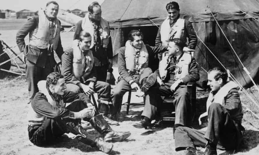 Pilots talking in front of tent