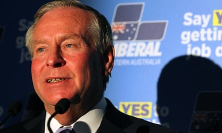 Colin Barnett in front of Liberal party signage