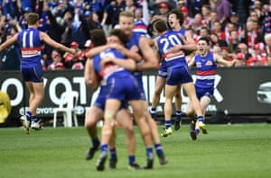 Bulldogs players reacts after winning the AFL Grand Final.