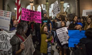People protest against the appointment of former Breitbart News head Stephen Bannon to be chief strategist of the White House by president-elect Donald Trump near City Hall in Los Angeles.