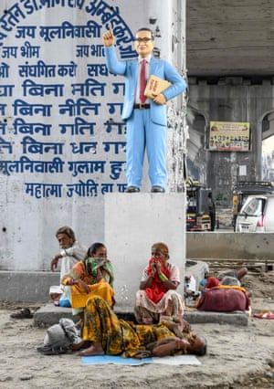 A statue of Bhimrao Ambedkar under a flyover in Amritsar, India.