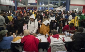 Thousands take shelter from the Tropical Storm Harvey at the George R. Brown convention center in Houston.