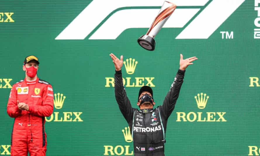 Lewis Hamilton celebrates his record-equalling world title win after victory at the Turkish GP, as Sebastian Vettel looks on