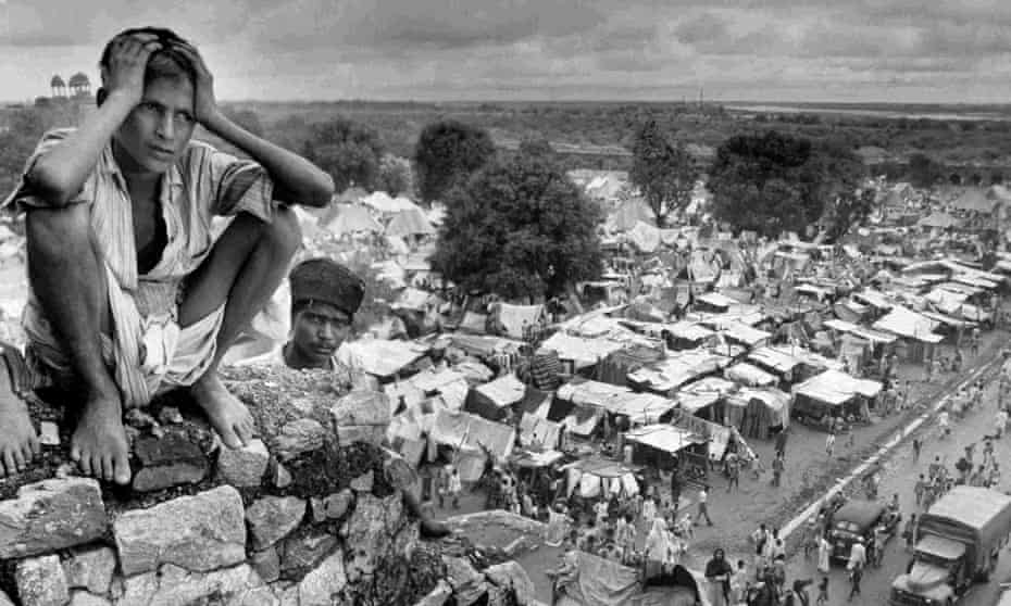 'Division and uncertainty': a boy on the wall of a Delhi refugee camp during Partition