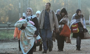 Migrants and refugees cross the border between Serbia and Macedonia