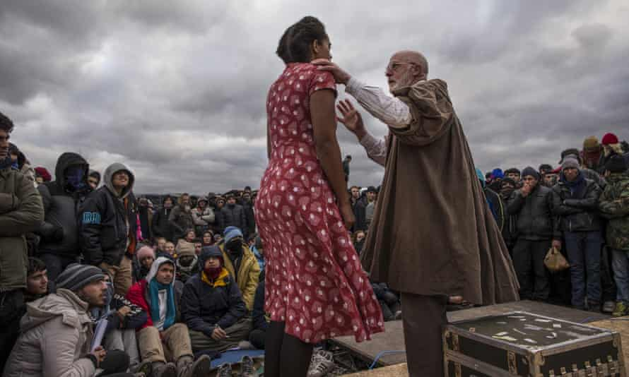 Shakespeare's Globe actors perform Hamlet to refugees from 22 different countries in the Calais Jungle.