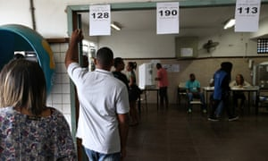 People queue to vote in the elections which have seen a record number of spoiled or blank ballots.