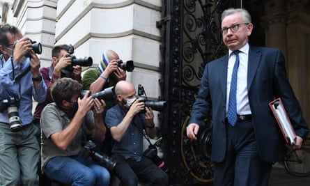 Michael Gove photographed by the media as he leaves the Foreign and Commonwealth Office