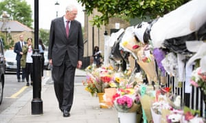 Sir Martin Moore-Bick looks at floral tributes to the Grenfell Tower dead.