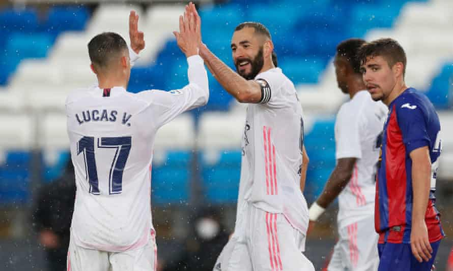 Karim Benzema (centre) celebrates scoring Real Madrid's second goal in their 2-0 win against Eibar on Saturday.