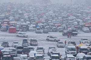 Heavy snow falls in the parking lot before an NFL playoff game at Arrowhead Stadium in Kansas City, Missouri.