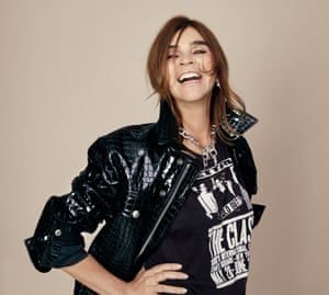 'I did everything first. But people forget, because people forget everything': Carine Roitfeld wears jacket and skirt by Tom Ford; Clash T-shirt her own; necklace by Dior. Makeup by Hugo Villard at Saint Germain Agency using Chanel; hair by Olivier Schawalder at Bryant Artists using Oribe.
