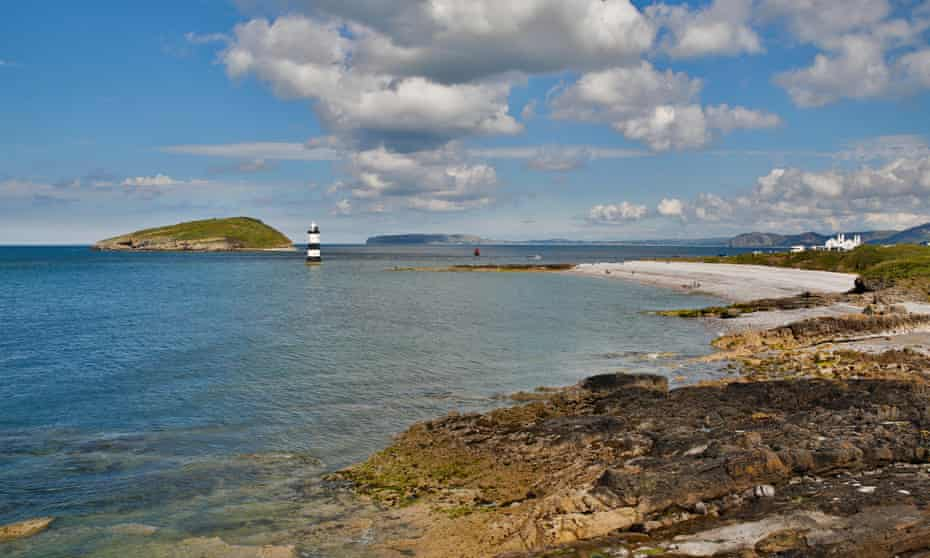Penmon Point, Anglesey, with beach and lighthouse