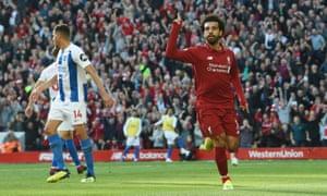 Liverpool's Mohamed Salah celebrates scoring the opening goal against Brighton.