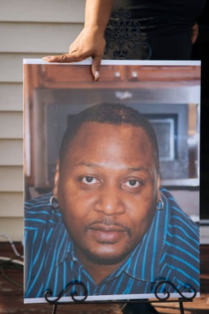 Carlene Veal rests her hand on a photo she took of her husband Walter.