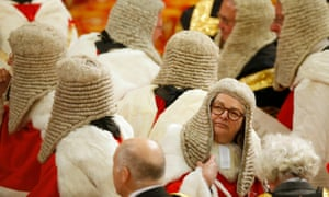 Members of the law lords wait for the Queen at the state opening of parliament, May 2016