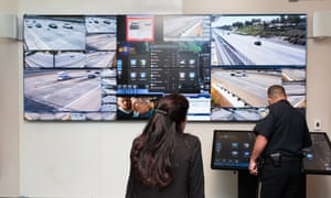 The Pittsburg police captain Patrick Wentz and the deputy district attorney for Contra Costa county Mary Knox monitor the Freeway Security Network command center, a system used to track down suspects in freeway shootings.